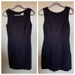 Black shift dress with scallop hem